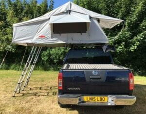 the biggest Ventura Deluxe roof tent, still just over the £1k mark. The specifications are very similar to the ones I have detailed under the Ventura Deluxe 1.4. The flysheet is made of a 420D polycotton Oxford fabric with PU coating, providing 1800mm HH resistance to water and UV protection as well. It is also anti-tear, however it's not clear if it's a Rip-Stop feature or just something that comes naturally with the stronger Oxford weaves. The fabric of the tent body is the same 420D Oxford polycotton, stretched onto an aluminium frame. The Ventura Deluxe 1.8 comes with two aluminum telescopic ladders that can be extended up to 2 metres.